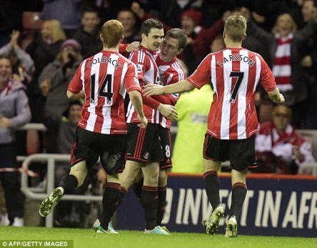Sunderland midfielder Adam Johnson celebrates scoring against his former club. (Image | Daily Mail)