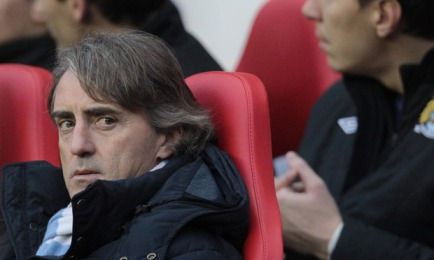 Frustration | Roberto Mancini looks on as his side drop further points in the title race. (Image | The Guardian)