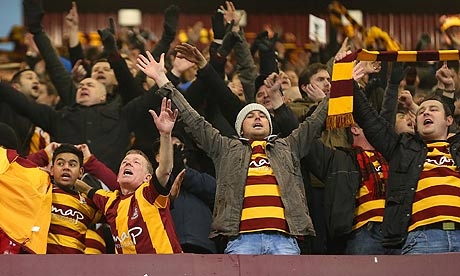 All aboard the Bantam bus | Bradford City fans celebrate their side's victory over Aston Villa. (Image | The Guardian)