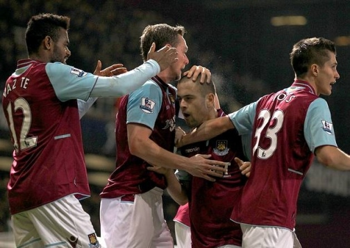 Cole-fired Irons | Cole is congratulated by his team-mates after setting up both goals against Manchester United. (Image | London24)
