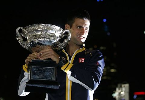 Super-Serb | Novak Djokovic holds the Australian Open trophy aloft after winning the tournament for the third year in a row. (Image | SGV Tribune)