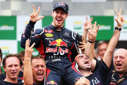 You little champ | Sebastian Vettel celebrates his third Drivers' World Championship win, in a sight Fernando Alonso must be getting sick of. (Image | The Motor Report)