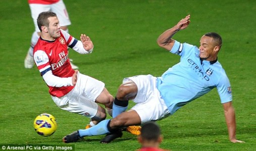 WORD | Manchester City defender Vincent Kompany scythes into Arsenal midfielder Jack Wilshere in a tackle that earned him a red card. (Image | Daily Mail)