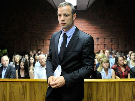 In the dock | Paralympian Oscar Pistorius stands in court in Pretoria, South Africa. (Image | The People)