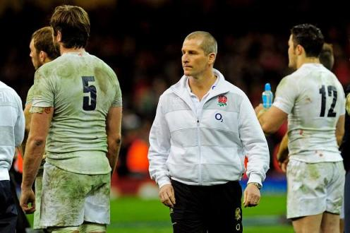 Hammering | England head coach Stuart Lancaster and his dejected players walk off after the defeat to Wales. (Image | The Sun)