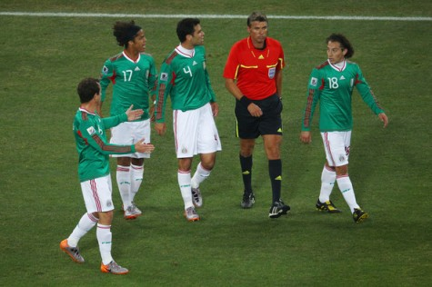 Dispute | Mexican players surround the referee as controversy reigns during their clash with Argentina at the 2010 World Cup. (Image | Bleacher Report)