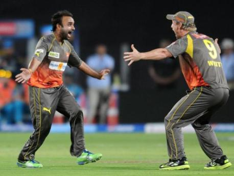 CAPTION | Sunrisers Hyderabad captain Cameron White celebrates with Amit Mishra (left) after his hat-trick against Pune Warriors. (Image | The Hindu)