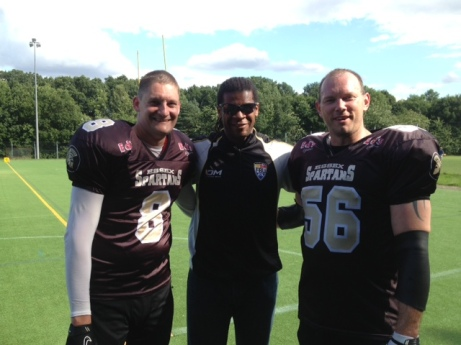 Guidance | Former Philhadelphia Eagles star Cecil Martin flanks two Essex Spartans players. (Image | Emma Webb)