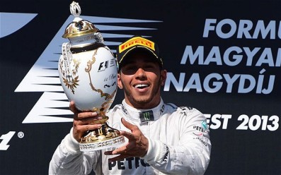 Relief | Lewis Hamilton holds the winner's trophy aloft after his first race victory for Mercedes. (Image | The Telegraph)
